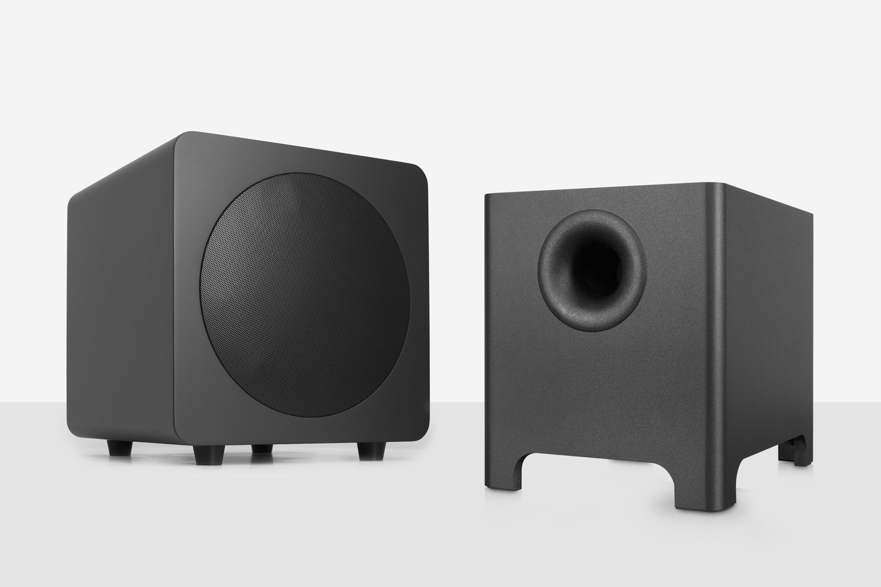 SUB8 next to a YURI subwoofer. Ported versus sealed subwoofers